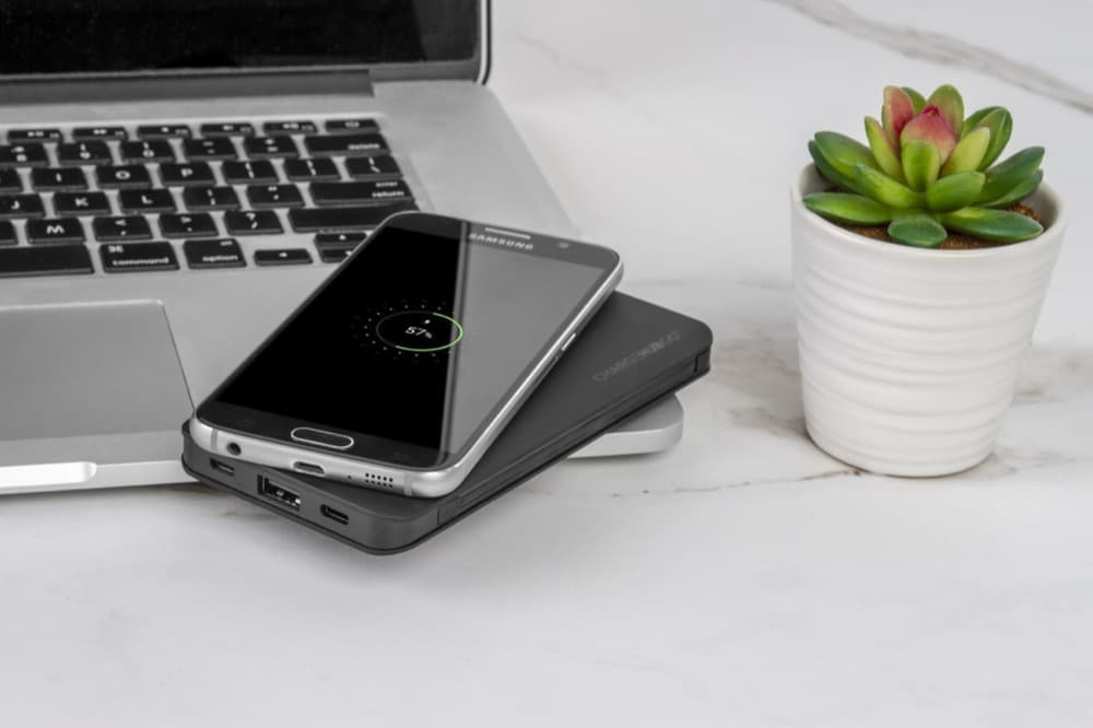ChargeHubGo portable battery bank with wireless charging capability for phones
